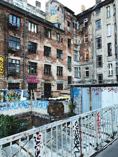 Old house in Berlin, Urban Szene Prenzlauer Berg Old House Grafitti Street Art Graffiti Wall Graffiti Berlin Architecture Architecturephotography Urban Wall Writing Built Structure Building Exterior Architecture Building Window No People Residential District Day City Sunlight Railing Wall