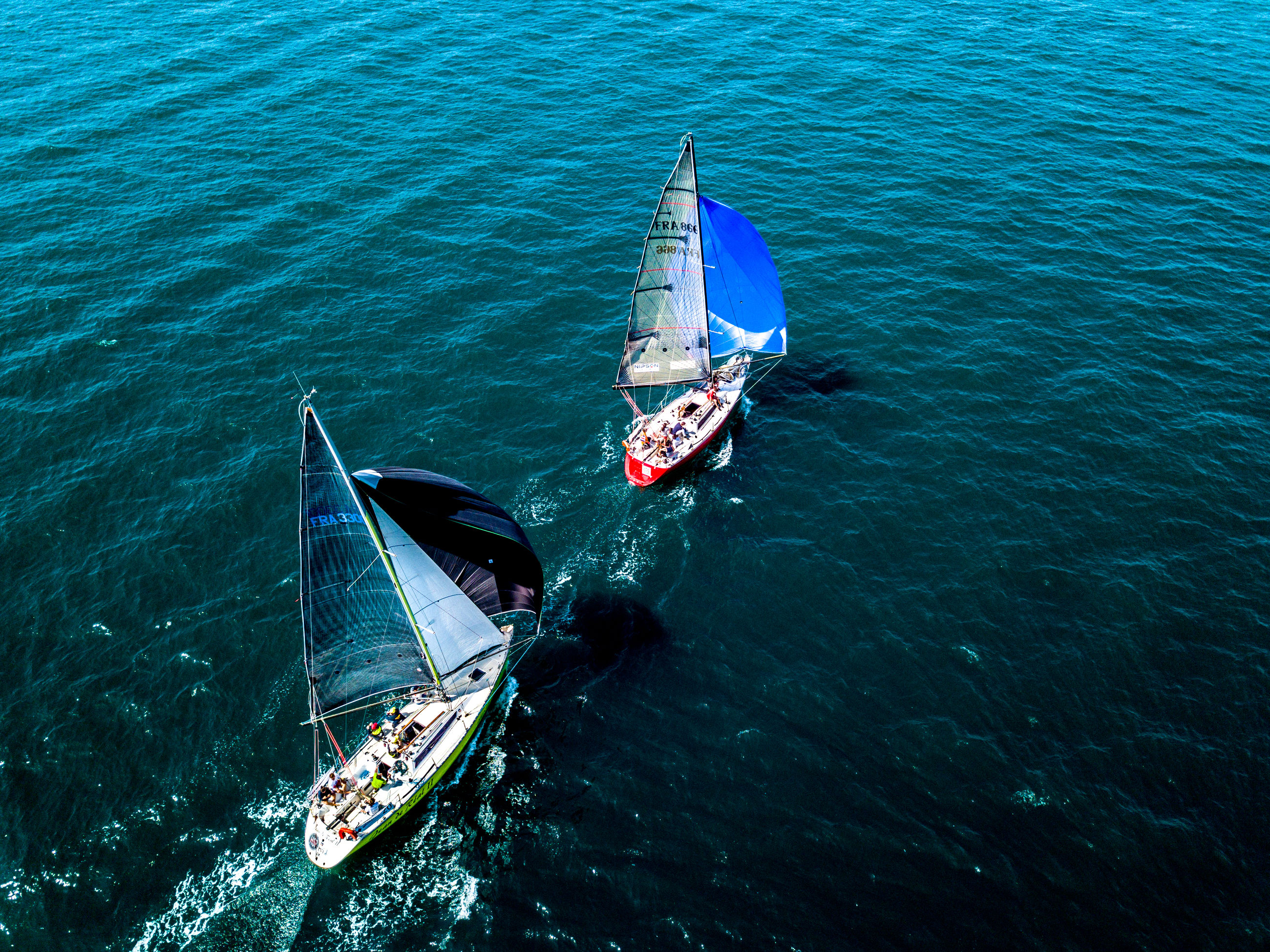 nautical vessel, water, transportation, mode of transportation, sea, high angle view, waterfront, nature, beauty in nature, day, outdoors, travel, sailing, sailboat, scenics - nature, rippled, blue, no people, yacht