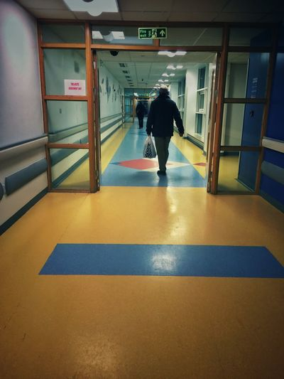 Real People Lifestyles Men Full Length Indoors  One Person Architecture Day Hospital Corridor Hospital Long Goodbye