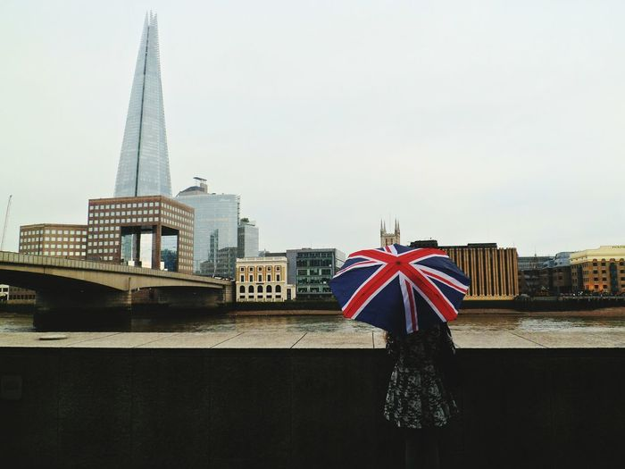 A British Shard Architecture Meeting Travel Connection Incidental People Tourism London Low Angle View Day Built Structure Bridge - Man Made Structure Travel Destinations Capital Cities  International Landmark People Outdoors Adults Only Umbrella Union Jack British Culture Woman On The Move Standing River Thames Showcase June EyeEm LOST IN London Postcode Postcards