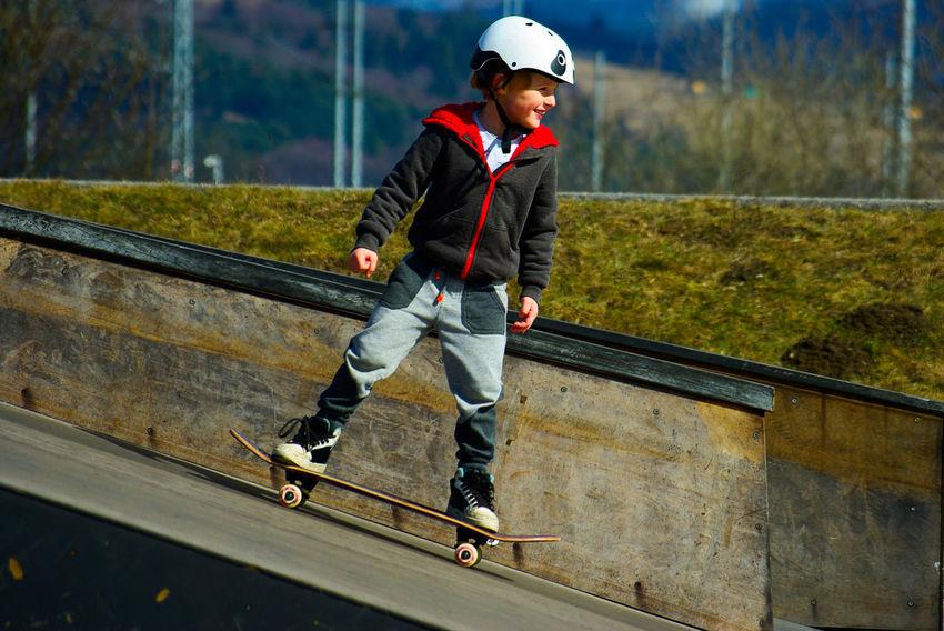Skateboarding Balance Boy Childhood Full Length Helmet Leisure Activity Lifestyles Motion Nature One Person Outdoors Skateboard Skateboard Park Skateboarder Skill  Sport