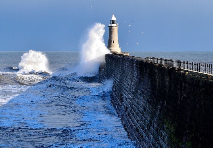 NORTHEASTENGLAND Postcode Postcards Architecture Beauty In Nature Blue Breaking Built Structure Clear Sky Crash Day Force Horizon Over Water Lighthouse Motion Nature No People North Shields Northeast Northsea Outdoors Power In Nature Sea Sky Splashing Tynemouth  Water Wave
