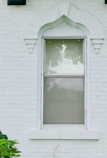 Close-up of window on white wall