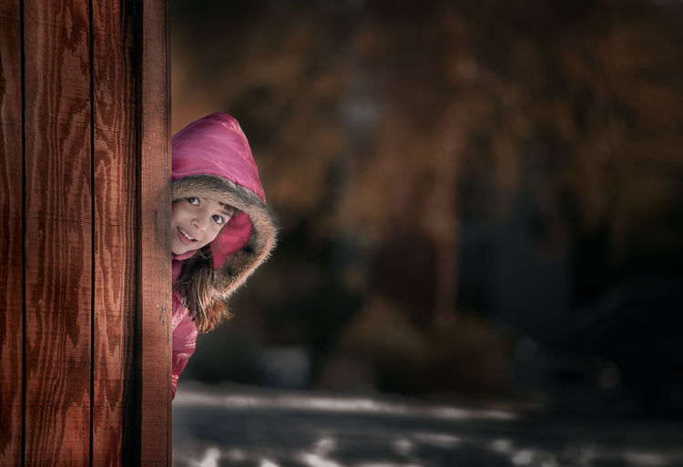Portrait One Person Clothing Smiling Looking At Camera Headshot Happiness Focus On Foreground Emotion Winter Pink Color Looking Hood - Clothing Red Warm Clothing 8 Years Old Females Little Kid Childhood Children Photography Children's Portraits Hidding