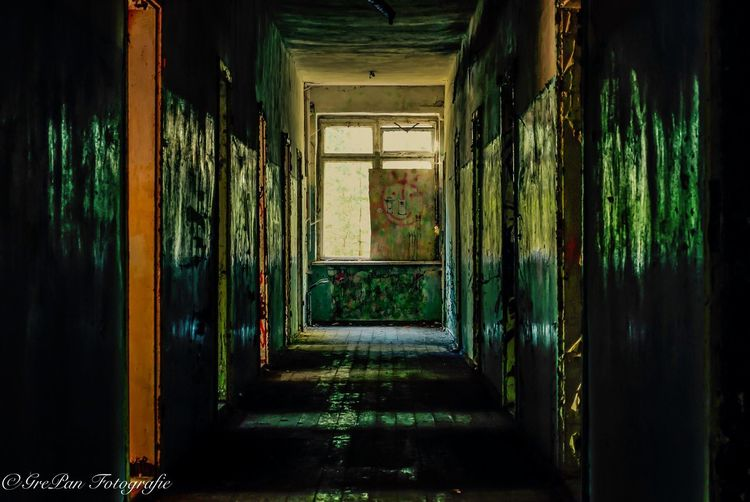 Indoors  Window The Way Forward Corridor Narrow Bad Condition Damaged Weathered Day Passage Long No People Dirty