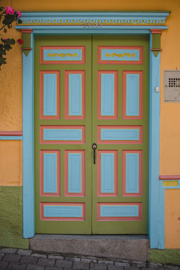 The colorful pueblito of Guatapé. South America Latin America Outdoors Day Explore Architecture Built Structure Building Exterior Building House Residential District City Entrance Door No People Closed Safety Security Protection Wall - Building Feature Blue Multi Colored Wood - Material Colorful Pattern Wood Paint Painted Springtime Decadence