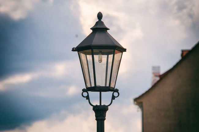 Outdoors Glass Travel Destination EyeEmNewHere EyeEm Selects No People Wall Polen Cloud - Sky Lanterns Light Bulb Old-fashioned City Lantern Electricity  Lamp Street Light Streetlamp Zgorzelec Sky Streetlife Day Lantern Light Evening Sky Evening Walk
