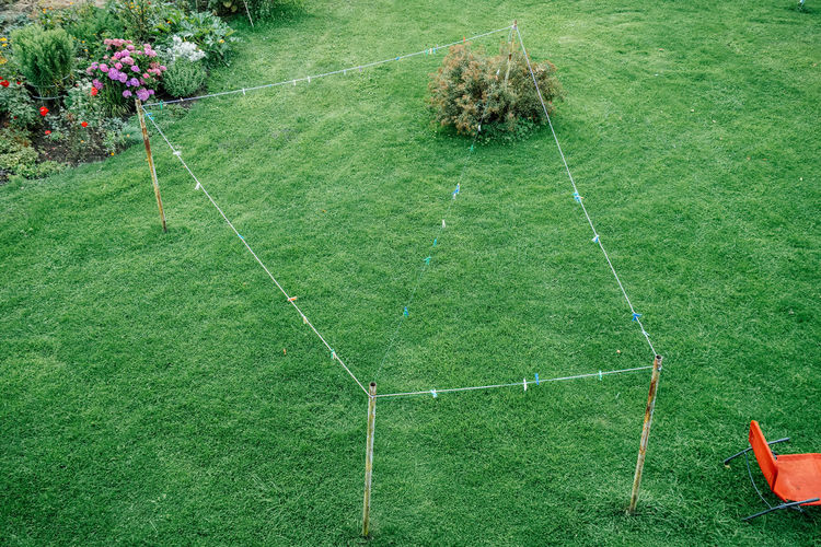 High angle view of clothesline over field