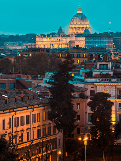Illuminated buildings in city at dusk in rome