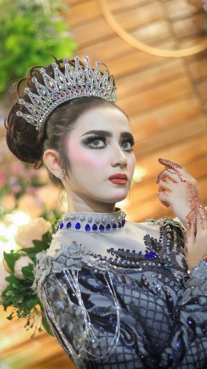 Low angle view of beautiful model wearing crown