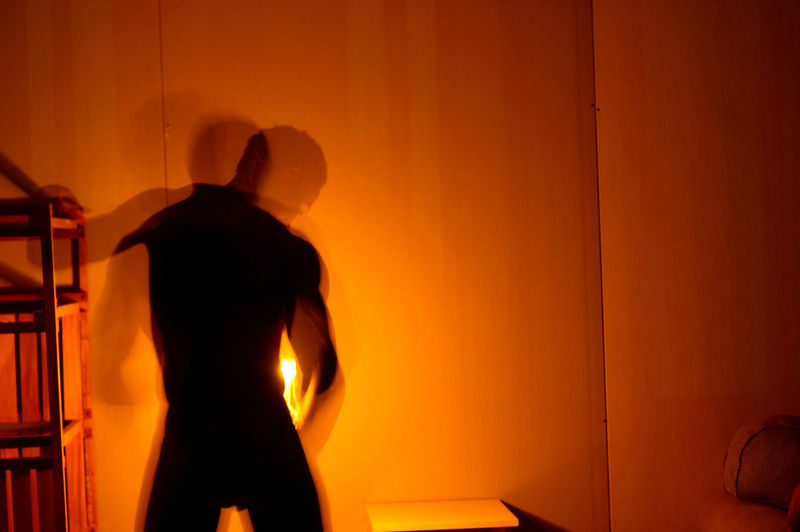 light, a slow shutter and an eager artist. Capture Tomorrow Indoors  Three Quarter Length Orange Color One Person Adult Standing Men Silhouette Waist Up Real People Illuminated Architecture Rear View Wall - Building Feature Night Occupation Clothing Lifestyles Entrance