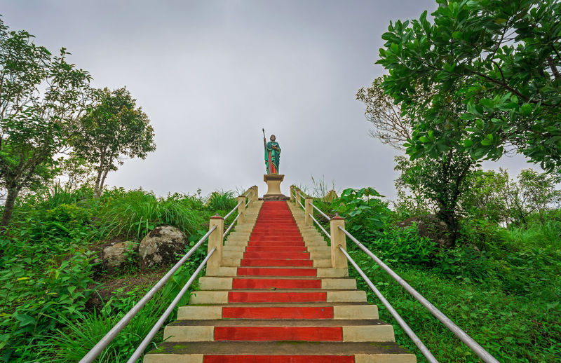 View of staircase leading towards temple against sky