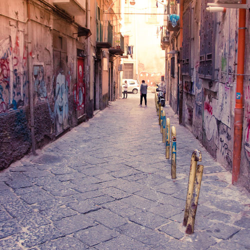 Naples Italy❤️ South Italy City Street Streetphotography Architecture Building Exterior Day Outdoors Footpath Paved Built Structure One Person Real People The Way Forward Building Direction Cobblestone Full Length Walking Men Incidental People Rear View Lifestyles Alley Paving Stone Light And Shadow