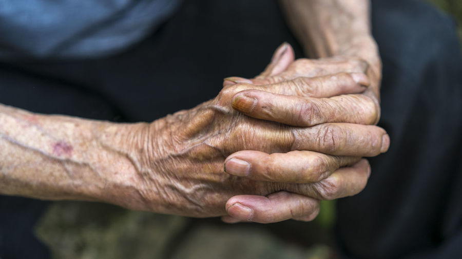 Close-up of human hand holding outdoors