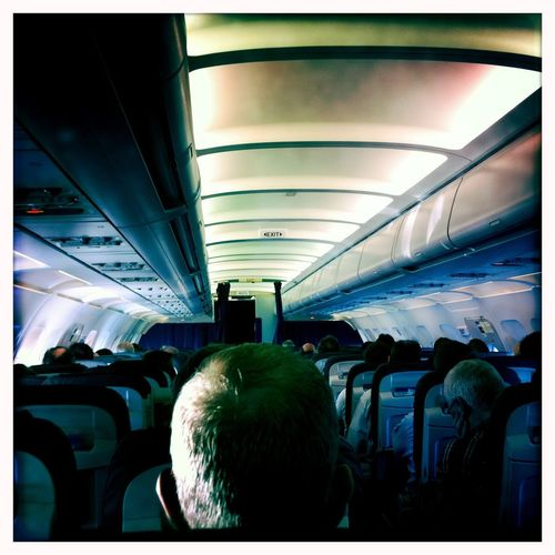 Man in plane Traveling Transportation Transfer Print Auto Post Production Filter Vehicle Interior Real People Rear View Men Airplane