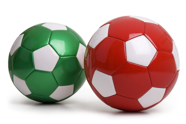Red and green soccer balls isolated on white background Christmas Green Isolated Ball No People Pair Red Soccer Ball Sport Sports Equipment Studio Shot White Background