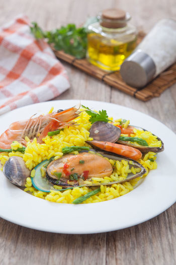 Man's accessories and jeans Clams Cooked Cuisine Food Gourmet Meal Meat Mussel Paella Prawn Rice Risotto Seafood SHELLFISH  Shrimp Spanish Spice Traditional
