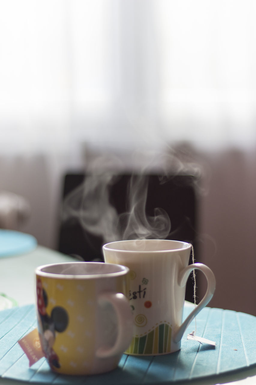 cup, mug, drink, coffee cup, coffee, food and drink, refreshment, smoke - physical structure, steam, coffee - drink, heat - temperature, table, indoors, tea, no people, close-up, hot drink, focus on foreground, crockery, tea - hot drink, tea cup, non-alcoholic beverage