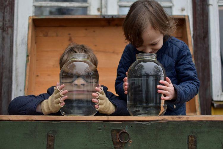 Close-Up Of Boy Water Jars