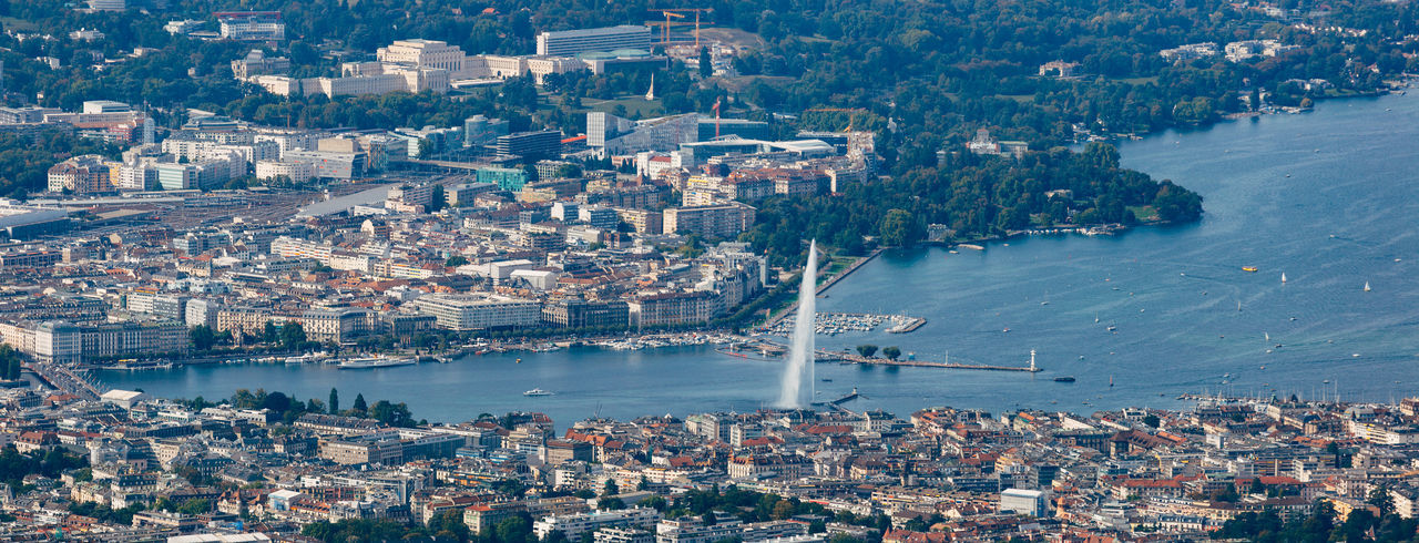 Aerial panoramic view of Geneva city center, water fountain and lake. Fountain Geneva Aerial View Architecture Building Exterior Built Structure City Cityscape Geneva Fountain Harbor High Angle View Lake Geneva Mode Of Transportation Nautical Vessel Outdoors Sailboat Transportation Travel Travel Destinations Water