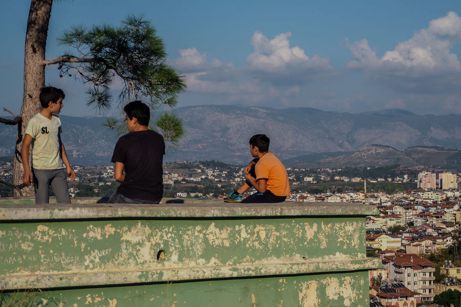Turkish People Architecture Boys Built Structure City City View  Cloud - Sky Day Friendship Leisure Activity Lifestyles Manavgat Men Mountain Nature On The Roof Outdoors People Real People Sky Standing Three Friends Togetherness Tree Turkey People