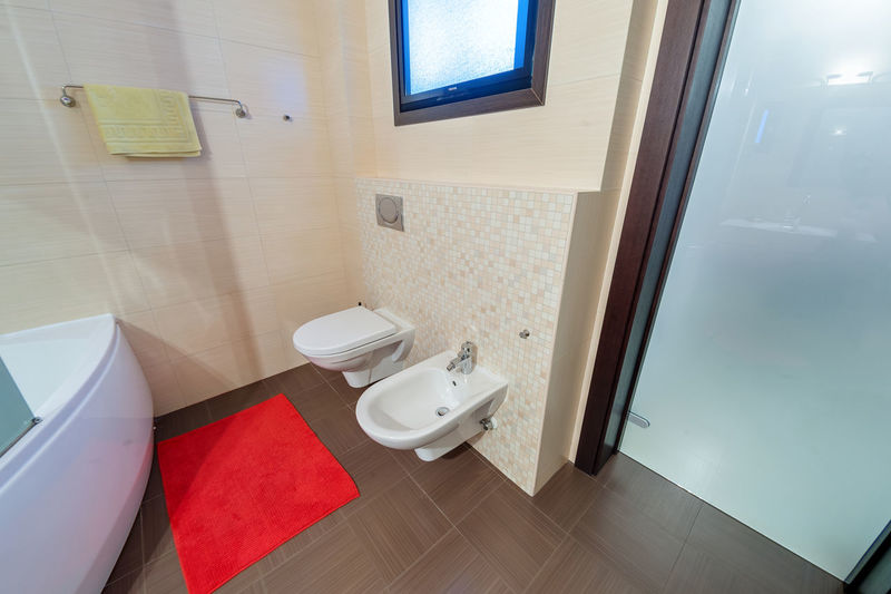 Bathroom Domestic Bathroom Toilet Indoors  Home Toilet Bowl Flooring Domestic Room Seat Hygiene No People Tile Home Interior Sink Luxury Modern Mirror Window Wealth Absence Tiled Floor