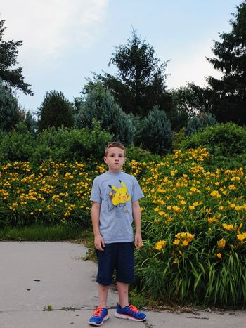 Visual Journal June 2017 Sunken Gardens Lincoln Nebraska A Day In The Life Always Taking Photos Boyhood Camera Work Childhood Elementary Age Everyday Lives EyeEm Gallery FUJIFILM X100S Hold Still Just Smile  Kids Being Kids Nature One Person Outdoors Photo Diary Photography Portrait Practicing Photography Rural America Standing Storytelling Underwhelming. Unhappy Visual Journal