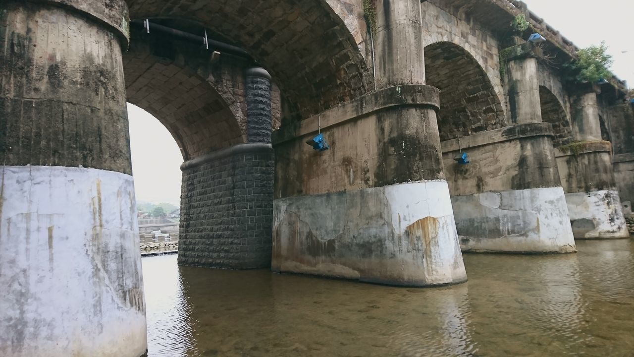 architecture, built structure, water, bridge, arch, bridge - man made structure, connection, waterfront, no people, day, nature, architectural column, old, outdoors, transportation, river, history, the past, underneath, arch bridge