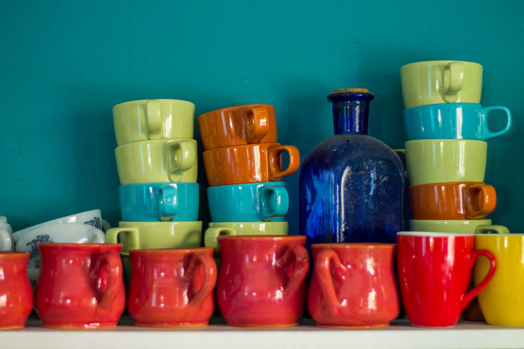 Abundance Arrangement Blue Blue Wall Choice Collection Colors Displayed Food Food And Drink Freshness In A Row Indoors  Indulgence Large Group Of Objects Mug Multi Colored Music No People Red Retail  Shelf Still Life Variation Vibrant Color