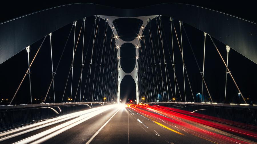 Light trails on suspension bridge
