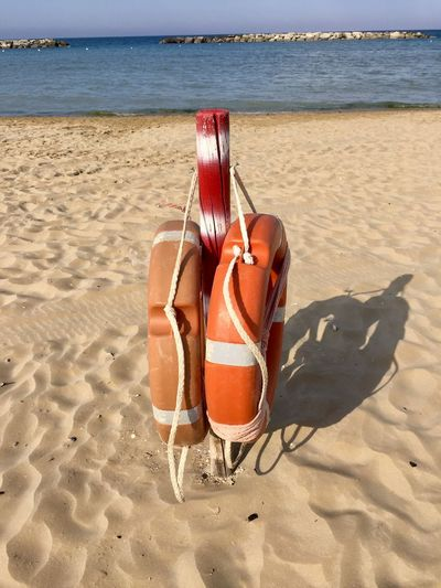 Life belts Absence Beach Blue Day Life Belt Lifestyles Light And Shadow Nature Nature No People Outdoors Pole Sand Sand & Sea Scenics Sea Shadow Sky Sommergefühle Summer Sunlight Tranquil Scene Tranquility Vacations Water