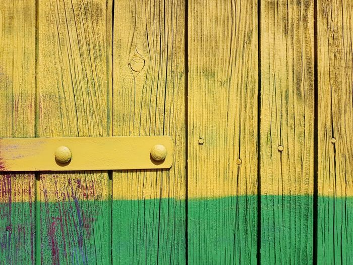 Full Frame Shot Of Yellow And Green Colored Wood Paneling