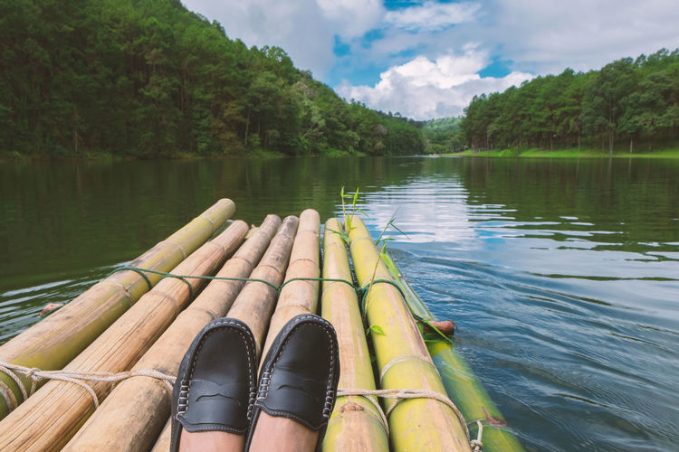 Bamboo - Material Beauty In Nature Cloud - Sky Day Forest Lake Low Section Nature Nautical Vessel Outdoors Park Raft Rafting Relaxing Moments Reservoir Scenics Sky Summer Tranquil Scene Tranquility Tree Vacation Water Woods