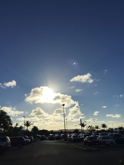 Hiding Sun Sunshine Sun Silhouette Dramatic Sky Check This Out Showcase: February Hello World Clouds And Sky Sky Clouds Cars Carpark Blue Wave