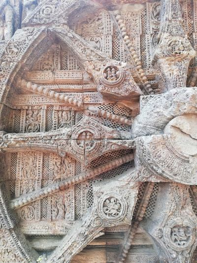 Full frame shot of carvings on wall of building