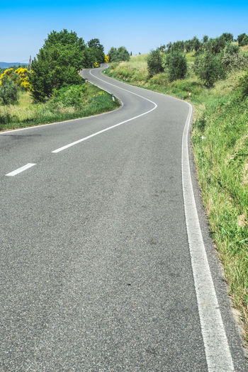 Road Italy Asphalt Travel Transportation Plant Tree Direction The Way Forward Sign Road Marking Symbol Day Marking Nature No People Sky Diminishing Perspective Landscape Green Color Land Grass Outdoors Dividing Line Long