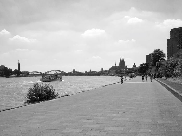 Architecture Built Structure City City Life Cityscape Cloud Cloud - Sky Cloudy Cologne Day Footpath Köln Lifestyles Mid Distance Nature Outdoors River Sky The Way Forward Tourism Travel Destinations Walkway Water