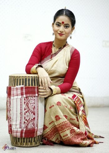 Assam's traditional dance bihu Only Women One Woman Only Adults Only Looking At Camera Sitting Portrait One Person Adult People Cultures Women Traditional Clothing Indoors  One Young Woman Only Sari Young Adult Bangle Day