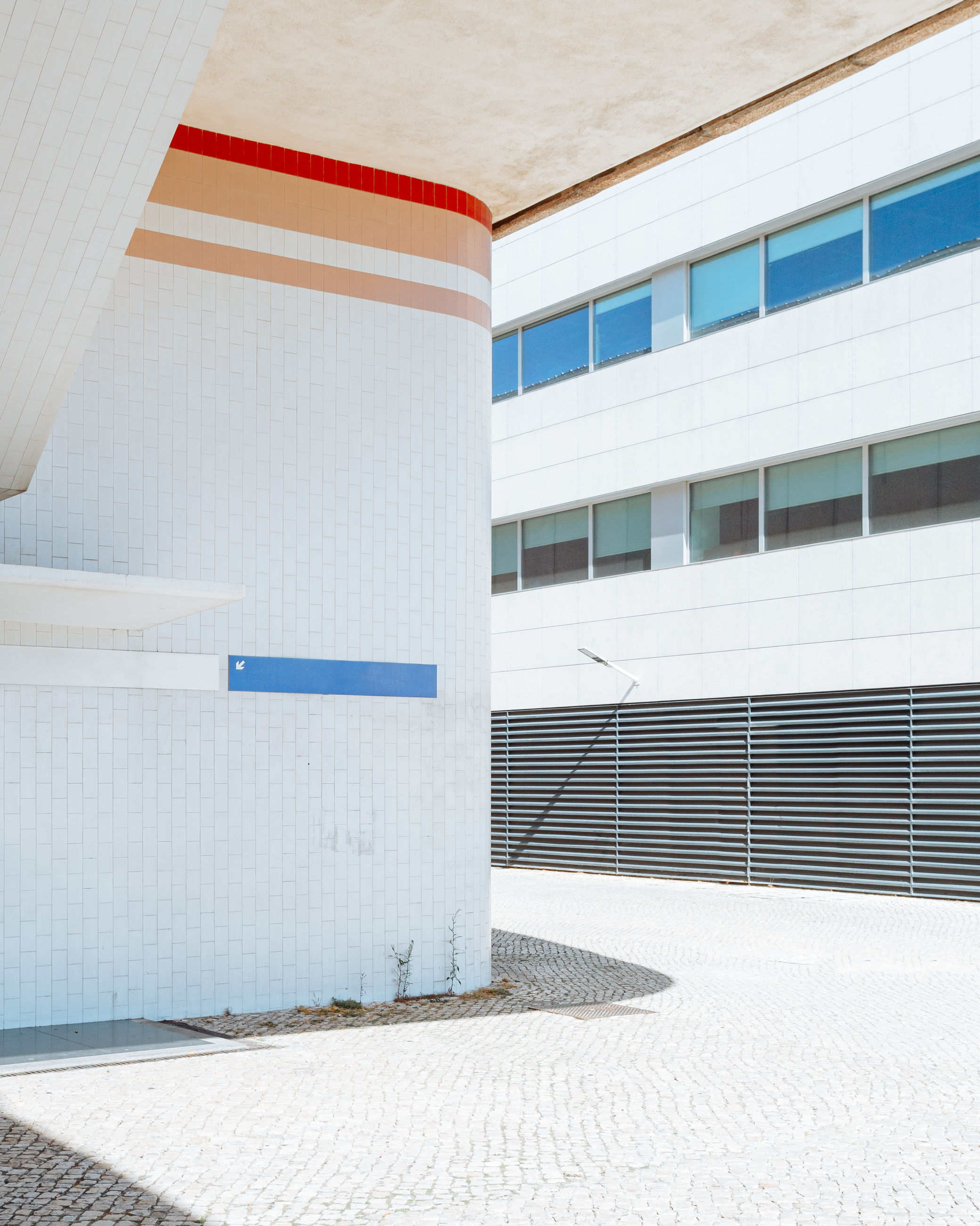 architecture, built structure, building exterior, building, no people, day, sunlight, nature, city, outdoors, white color, wall - building feature, blue, footpath, pattern, window, house, modern, flooring, wall