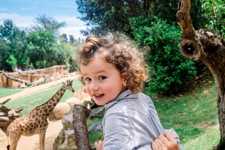 Portrait of smiling boy in zoo