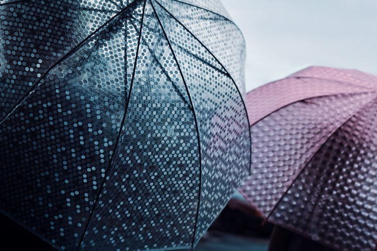Close-up of umbrella against sky