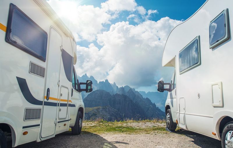 High Mountain Campers Camping. Two Motorhomes and the Scenic Mountain View. Outdoor and RVing Theme. Camping Dolomites Architecture Building Exterior Built Structure Camper Camping Cloud - Sky Day Journey Land Vehicle Mode Of Transportation Motor Vehicle Mountain Nature No People Outdoors Public Transportation Sky Stationary Transportation Travel White Color