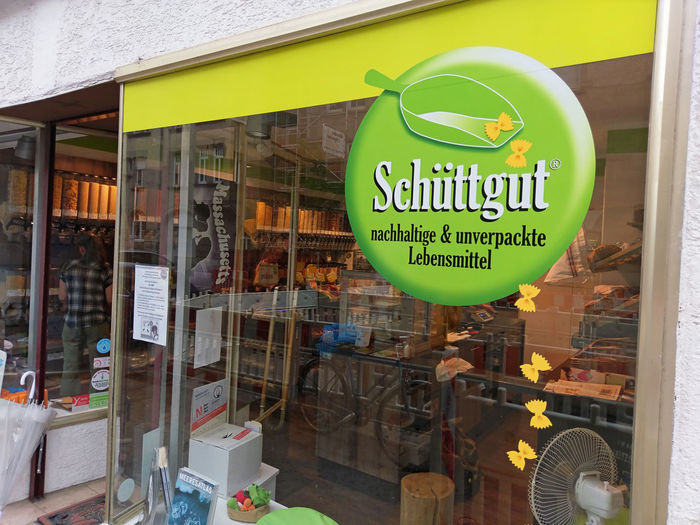"""Shop front of zero-waste shop """"Schüttgut"""". Jens-Peter Wedlich founded his zero-waste shop """"Schüttgut"""" in Stuttgart/Germany to fight against the increasing pollution of our world with plastic packaging waste. Plastic Environment - LIMEX IMAGINE Schüttgut Alternative Business Conservation Ecology Environment Environmental Protection Food And Drink Market Packaging Packing Plastic Plastic Material Retail  Retail Display Safe The Planet Shopping Sign Small Business Store Unpacked Wrapping Zero Waste"""