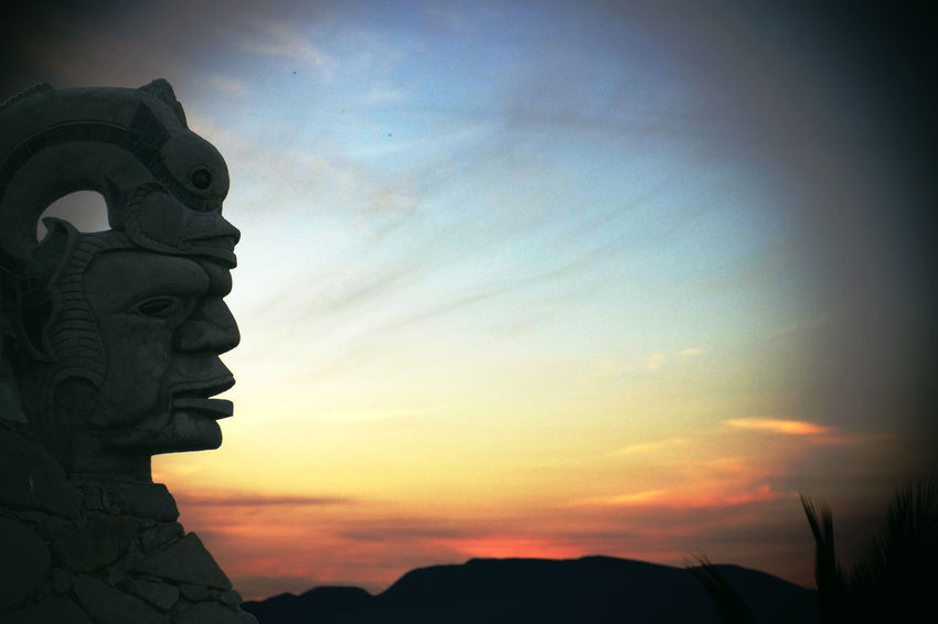 Sunset Silhouettes Beauty In Nature Cloud - Sky Day Low Angle View Nature No People Olmec Outdoors Prehispanic Scenics Sculpture Silhouette Sky Statue Sun Sunset