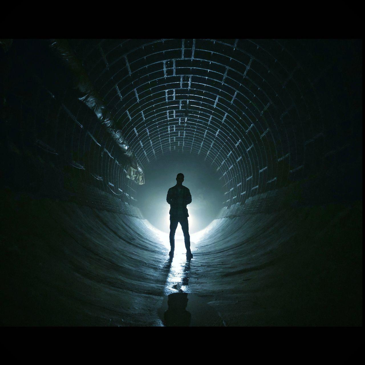 FULL LENGTH REAR VIEW OF SILHOUETTE MAN WALKING IN TUNNEL