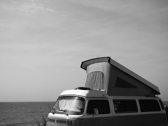 Motor Home By Sea Against Sky