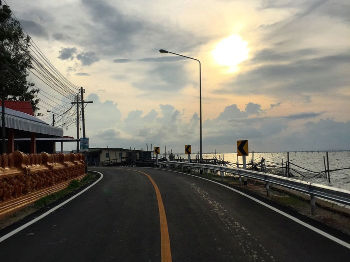 Road beside sea Asphalt Highway Curve Fast Speed Transportation Journey Travel Way Path Sun Sunset Sunlight Scenics Scenery Lake Landscape Sea Anemone Thailand Cloud - Sky Outdoors Road Sky Day No People Water Nature Beauty In Nature EyeEmNewHere