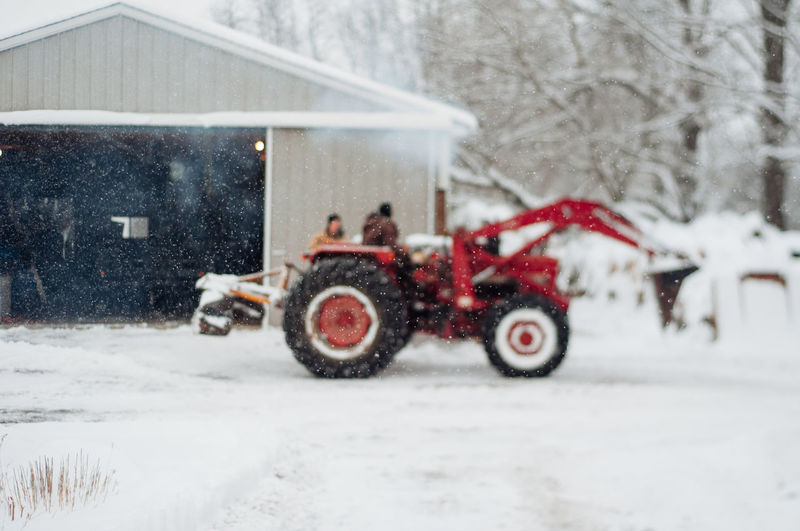 Snow Winter Cold Temperature Mode Of Transportation Building Exterior Architecture Nature Land Vehicle Transportation Tree Day Built Structure Snowing Frozen House White Color Building Covering Motor Vehicle Extreme Weather Blizzard Wheel