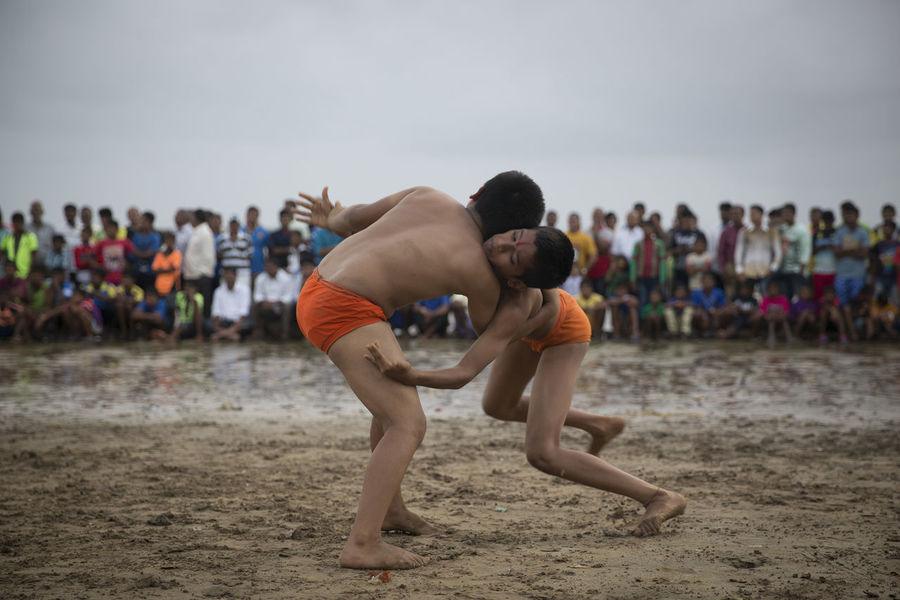 Young wrestlers engaged in a bout on the beach in Mumbai, India. Beach India Kushti M Playing Sand Sports Water Wrestlers Wrestling Wrestling Be