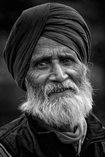 Close-up portrait of bearded man wearing turban